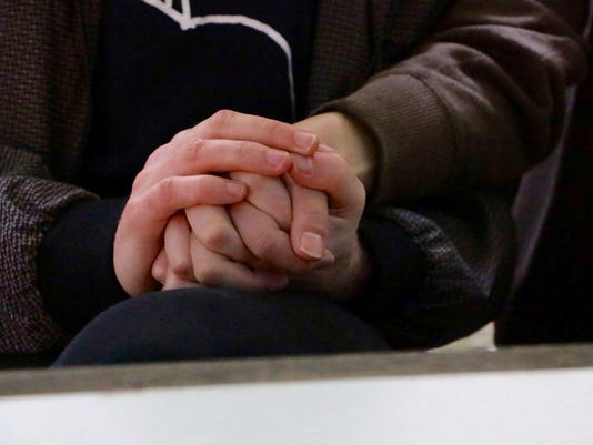 Two men holding hand