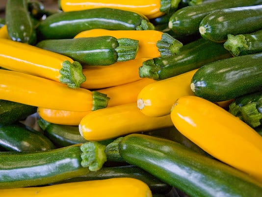 Green and yellow zucchini, close up, full frame