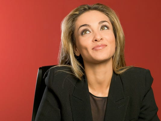 Businesswoman in black suit sitting with satisfied look on face, close-up