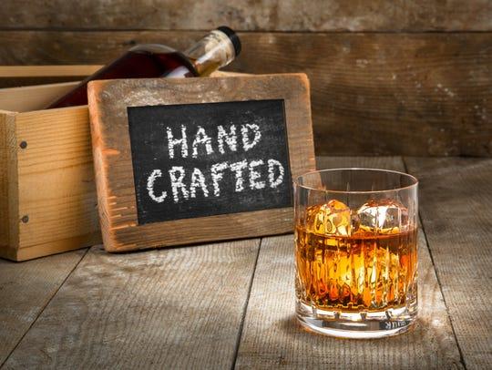 Barrel aged craft liquor spirits glass ice bourbon