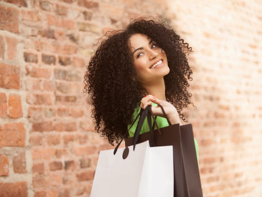 African american woman with shopping bags