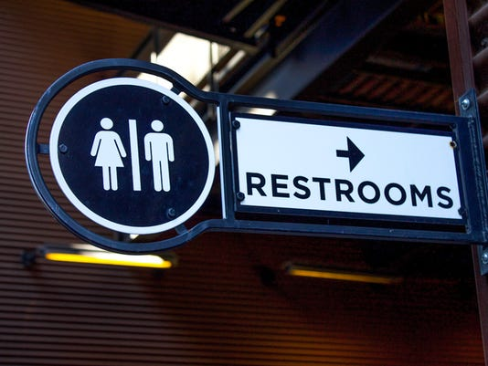#stockphoto Outdoor Metalic Restroom Sign Close Up