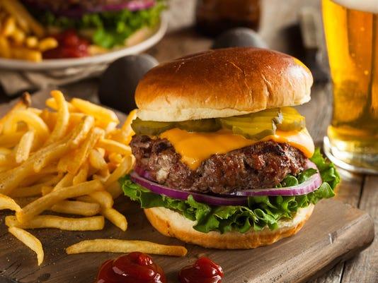 Huge grass fed bison hamburger with chips & beer
