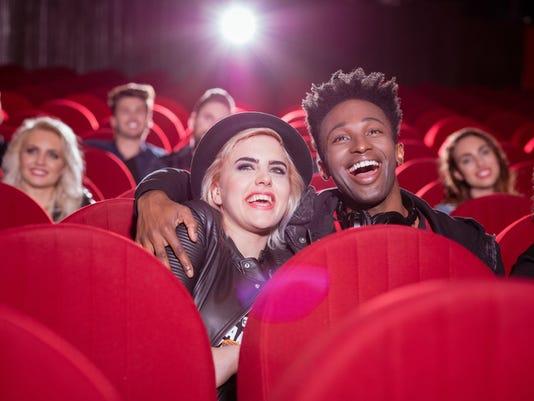 Multi ethnic couple in the movie theater