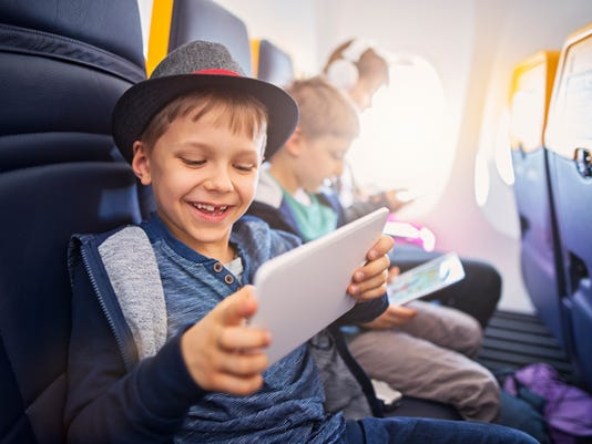 Happy kids travelling in plane