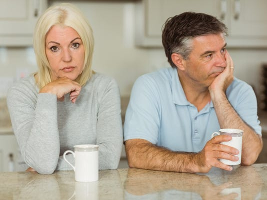 Mature couple having coffee together not talking