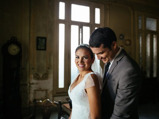 Bride and groom standing together in old house