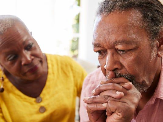 Senior Woman Comforting Man