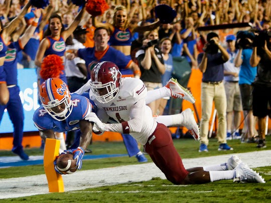 Florida wide receiver Brandon Powell (4) dives for