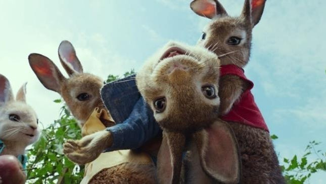 """James Corden provides the voice for the title character, center, in the animated comedy """"Peter Rabbit,"""" opening Friday."""