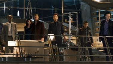 """This photo provided by Disney/Marvel shows, from left, Cobie Smulders, seated, Chris Evans, Don Cheadle, Claudia Kim, Chris Hemsworth, Robert Downey Jr., Jeremy Renner, Mark Ruffalo and Scarlett Johansson in the film, """"Avengers: Age Of Ultron."""" The movie releases in U.S. theaters on May 1, 2015. (Disney/Marvel via AP)"""