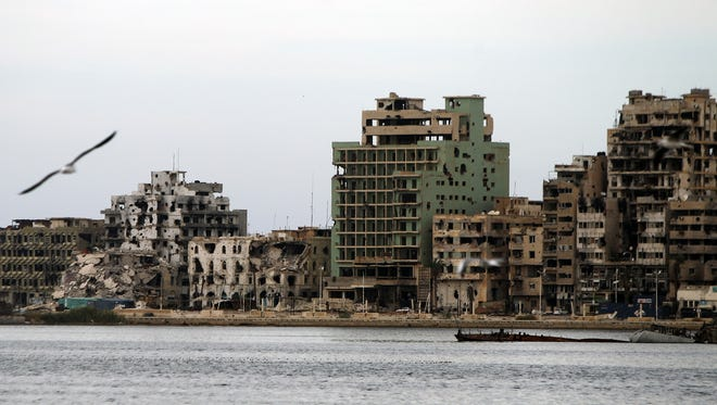 A general view shows destroyed buildings in Libya's eastern coastal city of Benghazi on Oct. 20, 2015. Clashes between soldiers of Libya's recognized government and anti-government forces, including the Islamic State group and several jihadi factions, continue to rage in the city as the country slides deeper into turmoil.