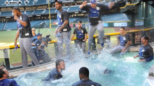 Los Angeles Dodgers jump into the pool at Chase Field in 2013 to celebrate their victory.