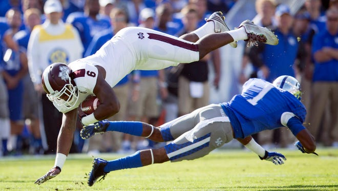 Mississippi State tight end Malcolm Johnson is upended by Kentucky safety A.J. Stamps during first half of an NCAA college football game at Commonwealth Stadium in Lexington, Ky., Saturday, Oct. 25, 2014. (AP Photo/David Stephenson)