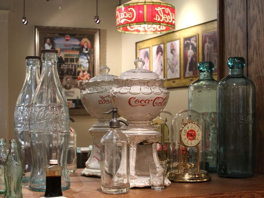 A display of Coca-Cola items at the Biedenharn Coke Museum.