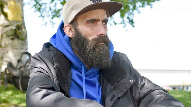 In this Wednesday May 3, 2017 photo, a man who wished to be identified only as Will recently took advantage of services offered by the Riverfolk non-profit group at People's Park near the downtown district in Astoria, Ore.. Riverfolk is also involved in trying to help the homeless population in the area obtain personal documents such as birth certificates and identification.