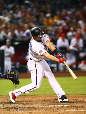 Jul 3, 2018; Phoenix, AZ, USA; Arizona Diamondbacks first baseman Paul Goldschmidt hits a three run home run in the fifth inning against the St. Louis Cardinals at Chase Field.