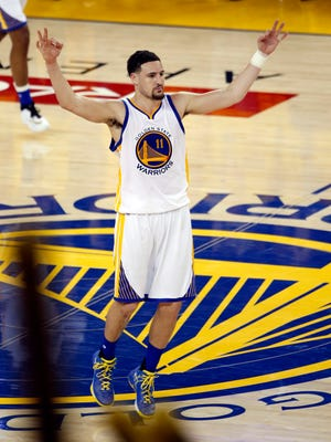Golden State Warriors guard Klay Thompson reacts after hitting a three point basket against the Cleveland Cavaliers in the NBA Finals.