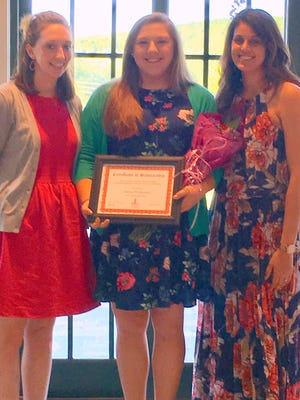 Junior League Grants Chair Katie Coletta, left, and Junior League President Christina Minier, right, join scholarship winner Allyson Wichtowski.