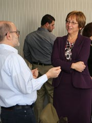 David Singer from Harrison and Barbara Cervoni from Bedford Hills chat during a March 9 meet-and-greet for lohud's Board of Contributors at The Journal News office in White Plains.