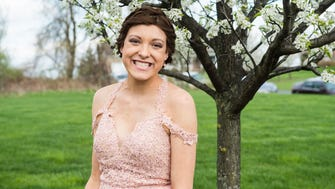 Alyssa White poses for a photo before heading to her high school prom on Friday, April 27, 2018.