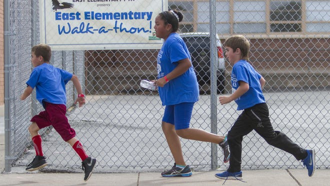 Students participate in the East Elementary Walk-a-thon, Friday, Oct. 16, 2015.