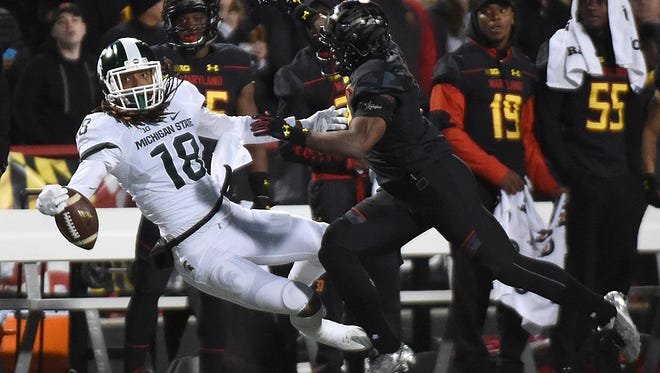 Maryland's cornerback JC Jackson, right, breaks up a pass to Michigan State's Felton Davis III in the first half of MSU's 28-17 loss Saturday in College Park, Md.