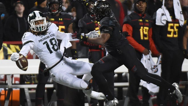 Maryland's cornerback JC Jackson, right, breaks up a pass to Michigan State's Felton Davis III in the first half of an NCAA college football game, Saturday, Oct. 22, 2016, in College Park, Md. Maryland won 28-17.