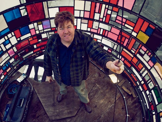 Tom Fruin, artist, inside one of his water tower sculptures.