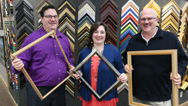 Manager Brent Allen, employee Anna England and founder Steve Narkaus stand in the newly renovated Elsinore Framing & Fine Art Gallery in downtown Salem. The gallery will now focus on original art by local and regional artists rather than prints.