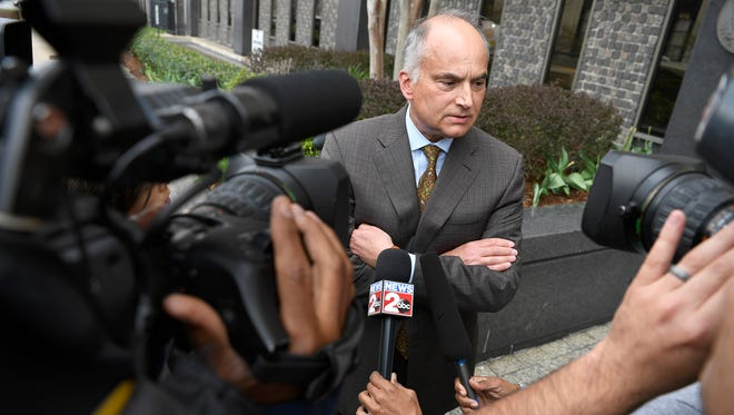 Judge Casey Moreland's attorney, Peter Strianse, speaks to the media outside the federal courthouse Friday, March 31, 2017, in Nashville.