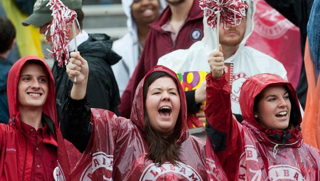 Alabama fans cheer as the team takes the field for warm ups against Georgia at Sanford Stadium in Athens, Ga. on Saturday October 3, 2015.