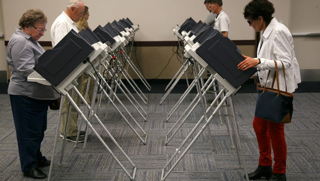Voters cast their ballots at the Dixie Center in St. George Tuesday, Nov. 4, 2014.