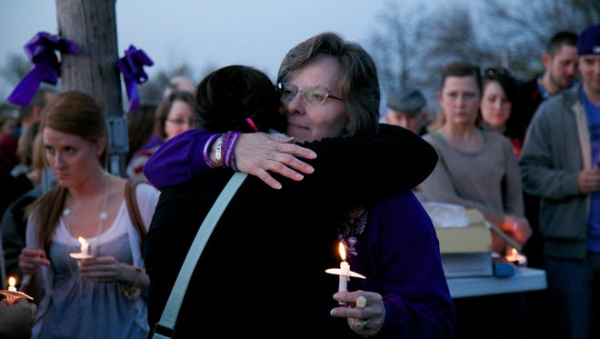 Leanndra Bruck, 52, of Maybee, the mother of Chelsea Bruck, during a candlelight vigil to commemorate the life of Chelsea Bruck on Tuesday, April 28, 2015 at St. Joseph Parish in Maybee, MI. Bruck's body was discovered near Charleton, MI, about 10 miles from where she was last seen walking with an unidentified man six months ago.