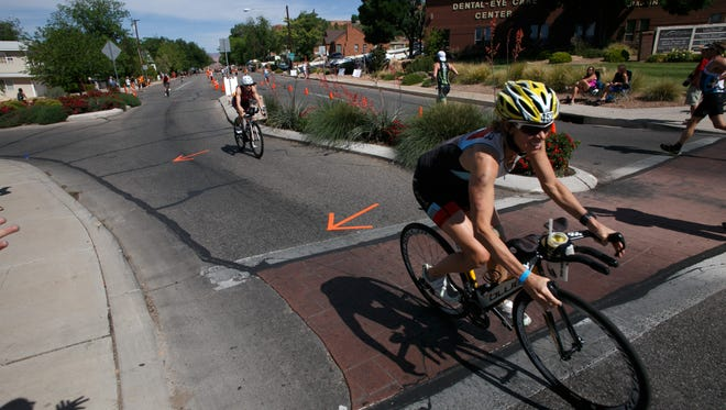 Ironman St. George competitors swim, bike and run during the 2105 running of the race Saturday, May 2, 2015. Major events like the Ironman have contributed to an increase in the number of cycling amenities offered throughout the southwest Utah area.