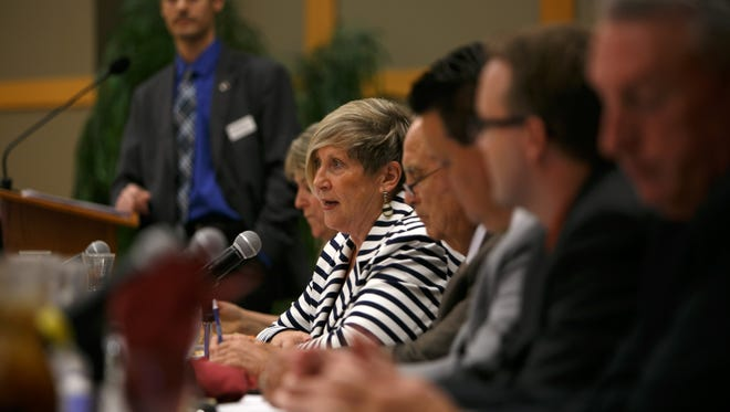 St. George City Council incumbent candidate Bette Ariel addresses the audience during a debate at the St. George Chamber of Commerce luncheon on the campus of Dixie State University.