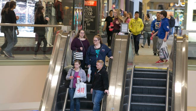 Shoppers make their way through Center Court of the mall. Black Friday shoppers at the Rockaway Townsquare Mall. The mall opened at 6 a.m. Rockaway, NJ. Friday, Nov. 27, 2015.Special to NJ Press Media/Karen Mancinelli/Daily RecordMOR 1128 Black Friday Rockaway Mall