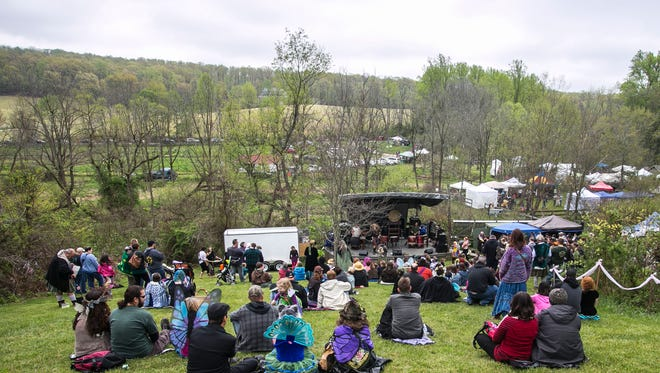 Attendees gather for the Cu Dubh concert at the 25th Annual Fairie Festival Saturday, April 30, 2016, at Spoutwood Farm in Codorus Township.  Amanda J. Cain photo