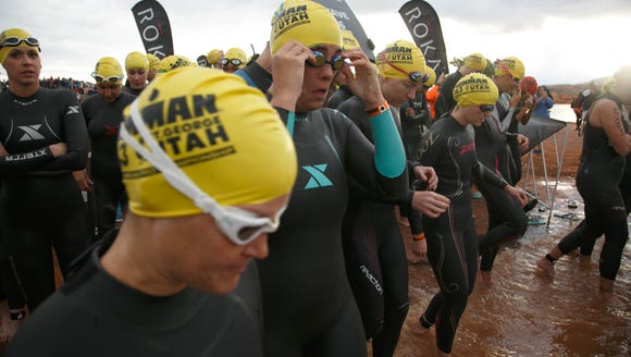 Ironman 70.3 St. George participants, including the
