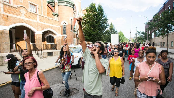 """Joell Cora, of York City, leads community members down Beaver Street in a """"No Justice, No Peace"""" chant during the anti-violence rally Friday, July 8, 2016. Amanda J. Cain photo"""