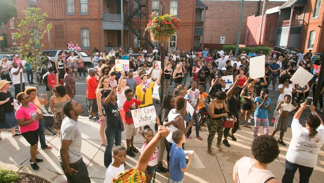 Hundreds of community members gather in front of the York City Police Department for an anti-violence rally Friday, July 8, 2016. Amanda J. Cain photo