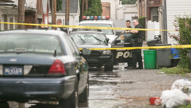 York City Police investigate after a 17-year-old was shot in the foot in the 600 block of Lincoln Street on Wednesday, July 13, 2016.  (Amanda J. Cain photo)