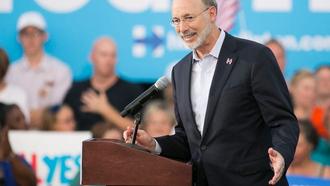 Gov. Tom Wolf addresses the crowd gathered for a Hillary Clinton campaign rally outside Broad Street Market on Friday, July 29, 2016, in Harrisburg. Amanda J. Cain photo