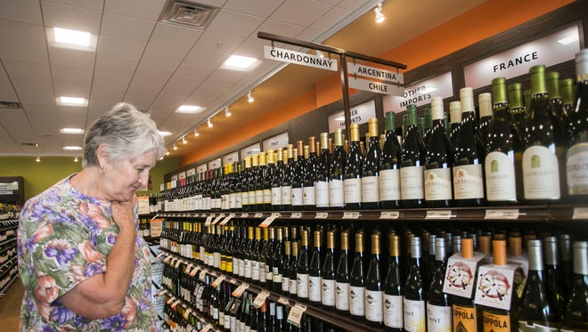 In this file photo, Bonnie Goodling, of Shiloh browses the Chardonnay section at Fine Wine & Good Spirits, in West Manchester Town Center Tuesday, Aug. 9, 2016.  Amanda J. Cain photo