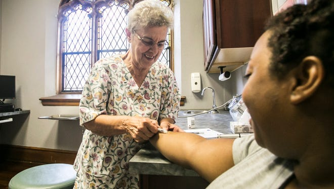 Nurse Margaret Thoman attends to Theresa Holland of York City during a appointment Tuesday, Aug. 16, 2016, at the Katallasso Family Health Center. The health center just received a $5,000 Grant for Healthy Living in Ethnic Communities, which is sponsored by the Pennsylvania Medical Society. Amanda J. Cain photo
