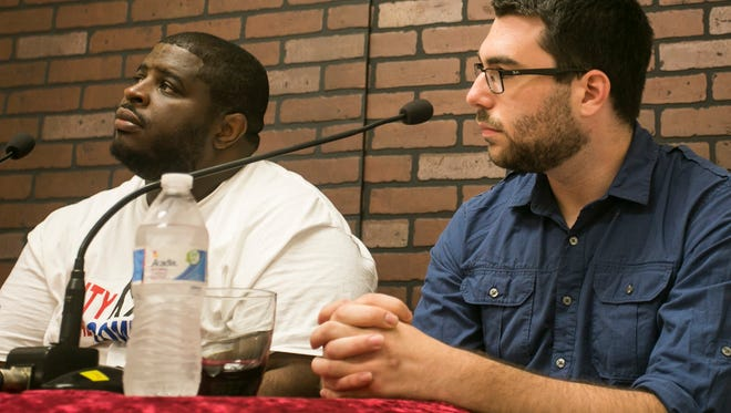 Philadelphia-based community activist Anton Moore, left, and York Dispatch reporter Sean Cotter discussed the CeaseFire York program on a cable-access show.