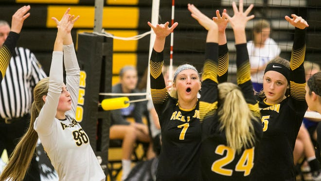 Red Lion players celebrate after winning a point during the fifth set of a York-Adams girls' volleyball match against Spring Grove Thursday, Sept. 15, 2016, at Red Lion Area Senior High School. Red Lion won 3-2. Amanda J. Cain photo