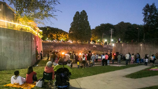 People gather around Foundry Park to watch the creek fire and live music Saturday, Sept. 24, 2016. Amanda J. Cain photo