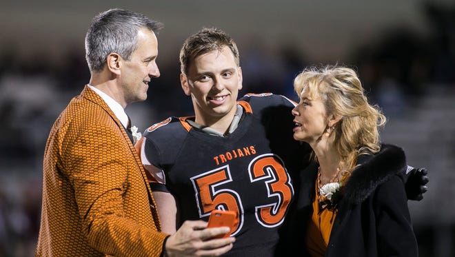 York Suburban lineman Gavin Barclay (center) celebrates Senior Night with his parents this fall. Barclay signed his national letter of intent to play football for FCS-program Lafayette College on Wednesday.   Amanda J. Cain photo