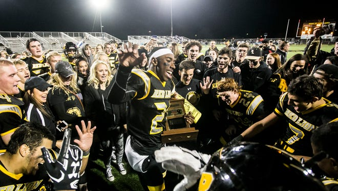 Red Lion's Paul Jones (21) leads his team in a celebration chant, after defeating Dallastown 27-7 in a York-Adams Division I league football game Friday, Nov. 4, 2016, at Red Lion Area Senior High School. Red Lion finishes the season 10-0. Amanda J. Cain photo